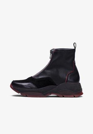 ANDES - Platform ankle boots - black