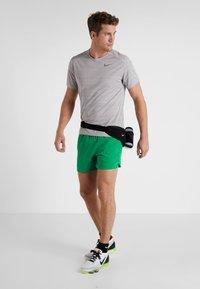 Nike Performance - AIR FLEX STRIDE - Sports shorts - lucid green/silver - 1