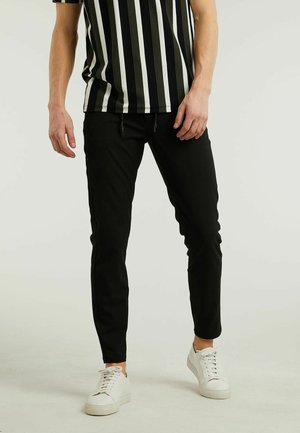 ACE.L LIONEL - Tracksuit bottoms - black