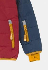 TrollKids - HAFJELL SNOW PRO UNISEX - Ski jacket - mystic blue/rusty red/golden yellow - 2