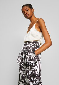 NEW girl ORDER - ABSTRACT TROUSERS - Spodnie materiałowe - black/white - 3