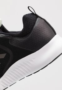 adidas Performance - EDGEBOUNCE 1.5 PARLEY - Sports shoes - core black - 5