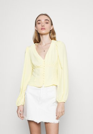 BUTTON FRONT BLOUSE WITH PLUNGING NECKLINE AND LONG SLEEVES - Pusero - pale lemon