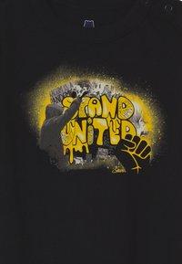 GAP - STAND UNITED UNISEX - Body - true black - 2