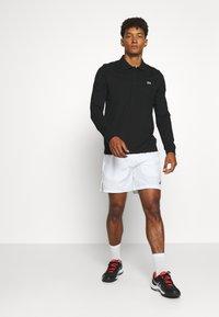 Lacoste Sport - CLASSIC - Polo shirt - black - 1