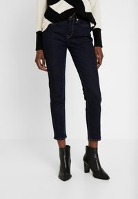 Tommy Hilfiger - PARIS CHRISSY - Slim fit jeans - blue denim - 0
