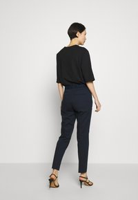 HUGO - HEFENA - Trousers - open blue