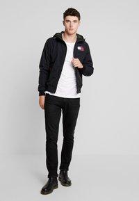 Tommy Jeans - JACKET - Light jacket - black - 1