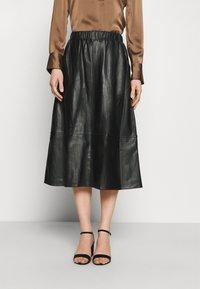 Marks & Spencer London - CIRCLE SKIRT - A-line skirt - black - 0