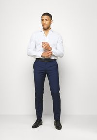 Tommy Hilfiger Tailored - SEPARATE PANT - Suit trousers - blue - 1