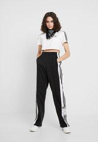 adidas Originals - ADIBREAK PANT - Tracksuit bottoms - black - 1