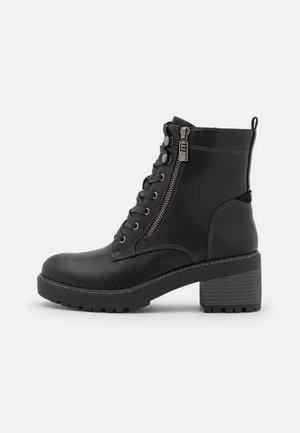DORIS - Šněrovací kotníkové boty - black