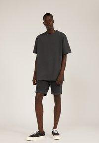ARMEDANGELS - AALEX - Basic T-shirt - acid black - 1