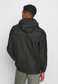Rains - STORM BREAKER UNISEX - Vodotěsná bunda - black - 2