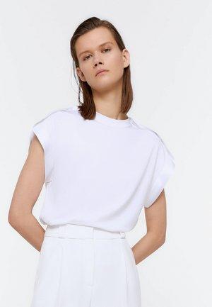 MIT ZIERBAND - Print T-shirt - white