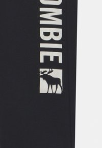 Abercrombie & Fitch - LOGO - Spodnie treningowe - black - 2