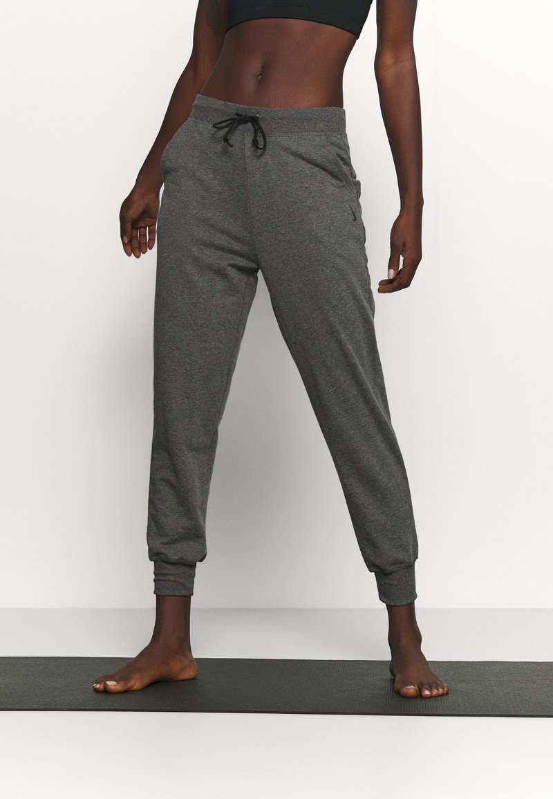 Nike Performance - Tracksuit bottoms - smoke grey