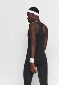 Hummel - HMLTIF SEAMLESS  - Camiseta de deporte - black - 2