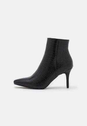 ROSITA - Ankle boot - black