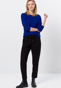 zero - RELAXED FIT - Tracksuit bottoms - black - 1