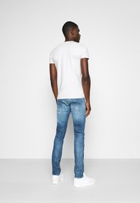 Replay - ANBASS AGED - Slim fit jeans - medium blue - 2