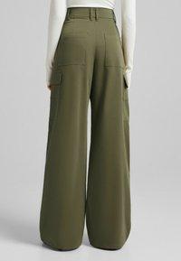 Bershka - Trousers - khaki - 1