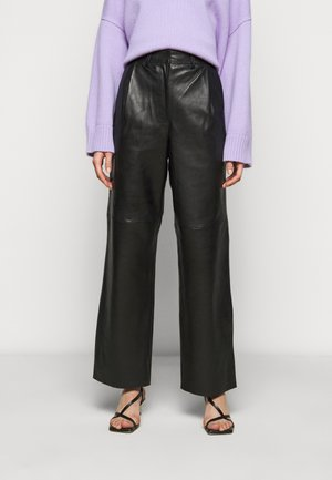 LUCAS - Leather trousers - black