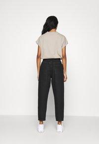 ONLY - ONLPLEAT CARROW - Trousers - black denim - 2