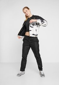 Puma - WARM UP PANT - Pantalones deportivos - puma black - 1