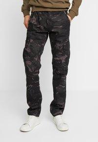 Alpha Industries - Cargo trousers - black camo - 0