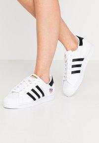 adidas Originals - SUPERSTAR  - Sneaker low - footwear white/core black/gold metallic - 0