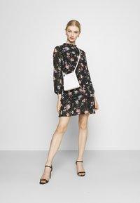 ONLY - ONLVIVIAN FLOWER FRILL DRESS - Denní šaty - black - 1