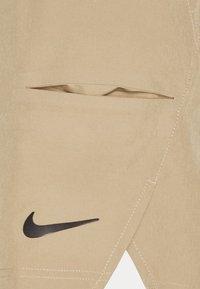 Nike Performance - Sports shorts - parachute beige/black - 6
