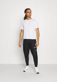 Nike Performance - PANT - Pantalon de survêtement - black - 1
