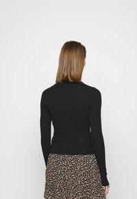 Hollister Co. - SLIM MOCKNECK - Long sleeved top - black - 2