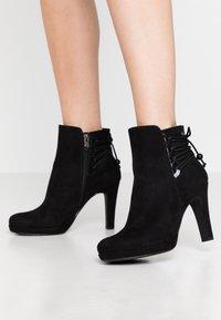 Tamaris - High heeled ankle boots - black - 0