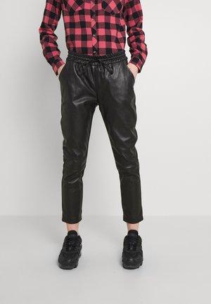 MINET - Trousers - black