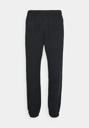 PHARRELL UNISEX - Spodnie treningowe - black