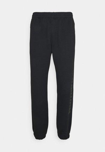 PHARRELL UNISEX - Teplákové kalhoty - black