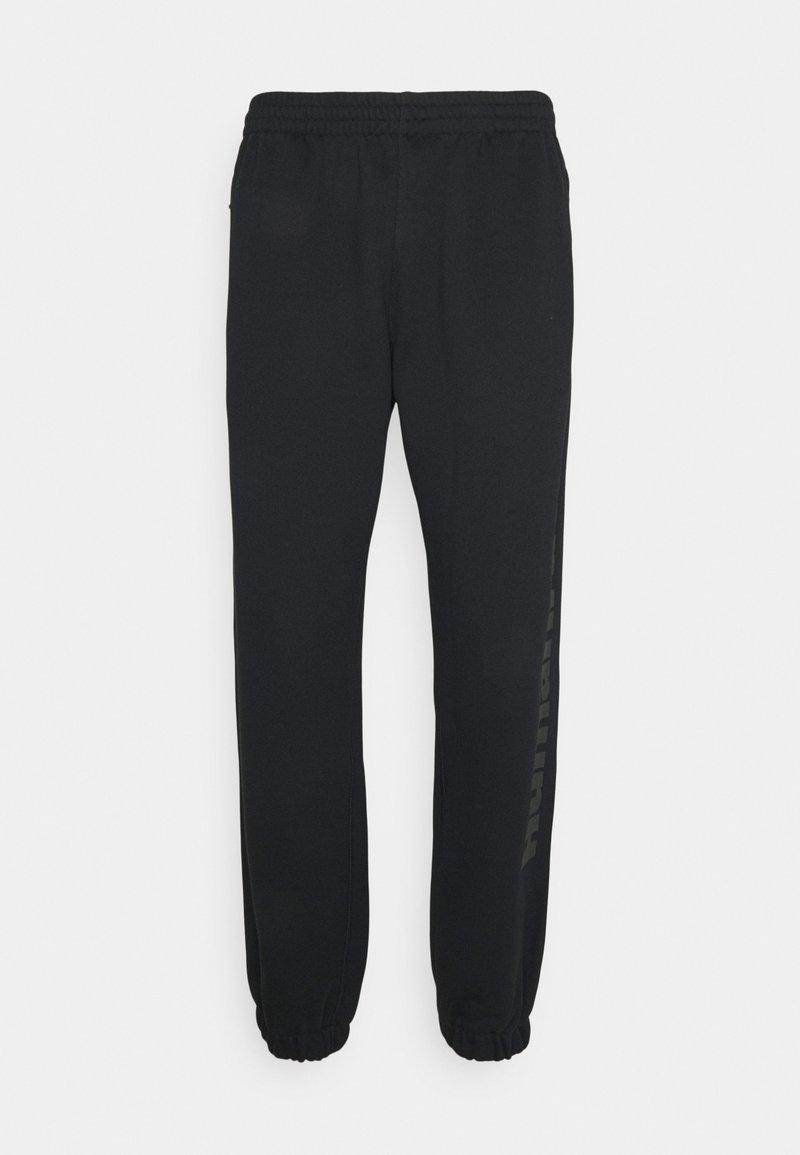 adidas Originals - PHARRELL UNISEX - Tracksuit bottoms - black