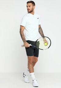 Mizuno - FLEX SHORT - Sports shorts - black - 1