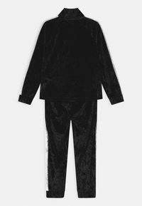 Nike Sportswear - CRUSHED TRACK SET - Tracksuit - black - 1