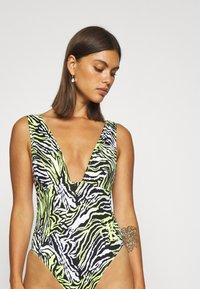 Calvin Klein Swimwear - PLUNGE ONE PIECE - Swimsuit - green - 3