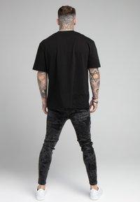 SIKSILK - DISTRESSED ELASTICATED  - Jeans Skinny Fit - black - 2