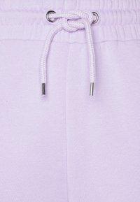Monki - KARDI PANTS - Tracksuit bottoms - lilac - 2