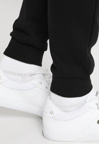Lacoste Sport - Tracksuit bottoms - black - 3