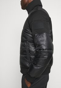 Calvin Klein Jeans - MATTE AND SHINE PUFFER - Giacca invernale - black - 5