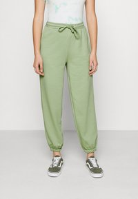 NA-KD - DRAWSTRING  - Tracksuit bottoms - green - 0