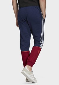 adidas Originals - OUTLINE JOGGERS - Tracksuit bottoms - blue - 1