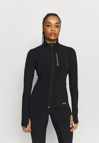 Casall - WINDTHERM JACKET - Sports jacket - black - 0